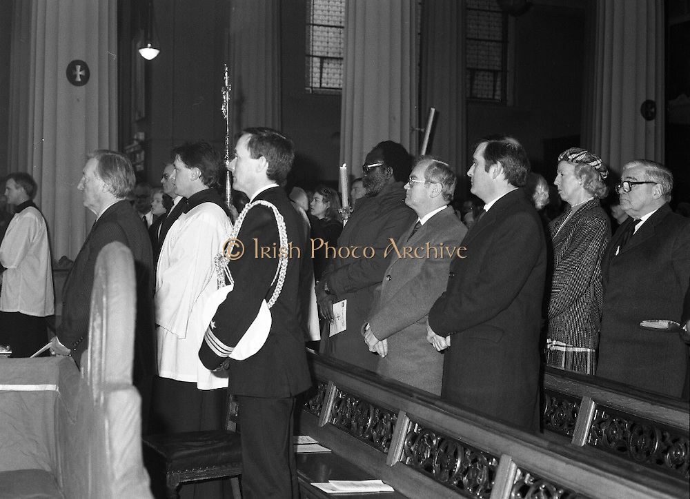Funeral Of Sean McBride.   (R71)..1988..18.01.1988..01.18.1988..18th January 1988..Today saw the Funeral of Seán McBride.Seán MacBride was an Irish government minister, a prominent international politician and a former Chief of Staff of the IRA. His funeral took place from the Pro-Cathedral in Dublin to the family plot in Glasnevin Cemetery, Dublin.The Chief mourners were Tiernan McBride,son, Anna White,daughter and Declan White, son in law...Image shows the congregation standing for the Gospel during the requiem mass for Sean