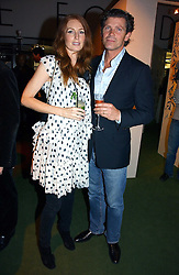 MR COLIN RADCLIFFE and model ANGELA DUNN at a party to launch the One T-Shirt by Edun held at Harvey Nichols, Knightsbridge, London on 18th October 2006.<br /><br />NON EXCLUSIVE - WORLD RIGHTS