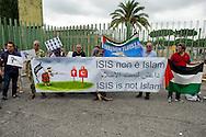 Roma, 19 Settembre  2014<br /> Manifestazione  contro  ISIS ( Stato Islamico).<br /> Uno striscione con la scritta: &quot;ISIS non &egrave; Islam&quot; esposto da un gruppo di italiani ed immigrati davanti alla Moschea Grande  di Roma, durante la preghiera del Venerdi.<br /> Rome, 19 September 2014 <br /> Demonstration against ISIS (Islamic State). <br /> A banner with the inscription: &quot;ISIS is not Islam&quot; exhibited by a group of Italian and immigrants  in front of the Grand Mosque of Rome, during prayers on Friday.