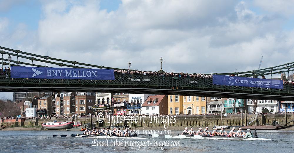London. UNITED KINGDOM.  1Both crews approaching Hammersmith Bridge. The 71st Newton Women's Boat Race on the Championship Course, River Thames, Putney/Mortlake.  Sunday  27/03/2016    [Mandatory Credit. Intersport Images]<br /> <br /> Oxford University Women's Boat Club {OUWBC} vs Cambridge University Women's Boat Club {CUWBC} <br /> <br /> Oxford, Crew Cox &ndash; Morgan Baynham-Williams, Stroke &ndash; Lauren Kedar, 7 &ndash; Maddy Badcott, 6 &ndash; Anastasia Chitty, 5 &ndash; Elo Luik, 4 &ndash; Ruth Siddorn, 3 &ndash; Joanneke Jansen, 2 &ndash; Emma Spruce, Bow &ndash; Emma Lukasiewicz<br /> <br /> Cambridge, Crew Bow Ashton Brown, 2 Fiona Macklin, 3 Alice Jackson, 4 Thea Zabell, 5 Daphne Martschenko, 6 Myriam Goudet, 7 Hannah Roberts, Stroke Zara Goozee, Cox Rosemary Ostfeld.