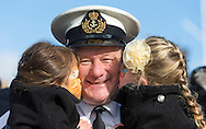Warrant Officer Dan Scanlon from Portsmouth hugs his daughters Katie 3, (left) and Molly 4, after the Type 23 frigate HMS Richmond returned to Portsmouth Royal Navy Base following a seven-month deployment to the South Atlantic. Picture date: Friday 21st February, 2014. Photo credit should read: Christopher Ison. Contact chrisison@mac.com 07544044177