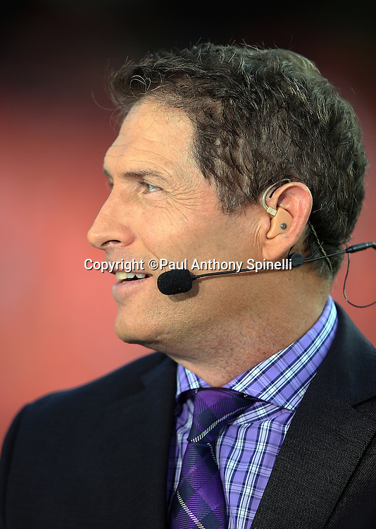 Television football analyst Steve Young appears on the ESPN sideline set at the Kansas City Chiefs NFL week 4 regular season football game against the New England Patriots on Monday, September 29, 2014 in Kansas City, Mo. The Chiefs won the game 41-14. ©Paul Anthony Spinelli
