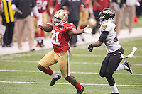 3 February 2013: Running back (21) Frank Gore of the San Francisco 49ers runs the ball and stiff arms (24) Corey Graham of the Baltimore Ravens during the second half of the Ravens 34-31 victory over the 49ers in Superbowl XLVII at the Mercedes-Benz Superdome in New Orleans, LA.