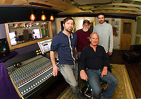Ryan Ordway, Franz Haase, Cameron McGonagle and Alan Loudon (seated) at their recording studio for the Recording Coop in Gilford Wednesday morning.  (Karen Bobotas/for the Laconia Daily Sun)