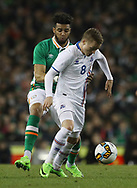 Cyrus Christie of Republic of Ireland tackles Aron Sigurdarson of Iceland during the International Friendly match at the Aviva Stadium, Dublin<br /> Picture by Lorraine O'Sullivan/Focus Images Ltd +353 872341584<br /> 28/03/2017