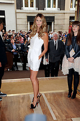ELLE MACPHERSON at a party to celebrate the opening of the Louis Vuitton Bond Street Maison, New Bond Street, London on 25th May 2010.