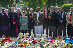 The former Archbishop of Southwark Kevin McDonald and Imam Ali of the British Armed Forces lay a wreath in memory of Drummer Lee Rigby with other religious leaders and MP's, Woolwich Barracks, South London, <br /> Friday, 31st May 2013<br /> Picture by i-Images