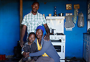 Masixole Magadla and family. Masixole used to stay on a property where he worked as a maintenance man. When the property was sold he lost his job and his home. With no where else to go he has moved up to Bold point and built a house for his family.<br /> <br /> During Apartheid the workers in the mountain retreat town of Hogsback were not allowed to own their own property. They had to reside on their employer&rsquo;s properties or commute from the Ciskei homeland in the valley below.<br /> <br /> Since the early 1990&rsquo;s the workers in Hogsback have been trying to get the go ahead for a low cost housing development but continue to face delays and legal challenges. The Legal Resources Centre is representing the Hogsback workers in negotiations to find a suitable site for the low cost housing development.<br /> <br /> &copy;Zute &amp; Demelza Lightfoot / Legal Resources Centre