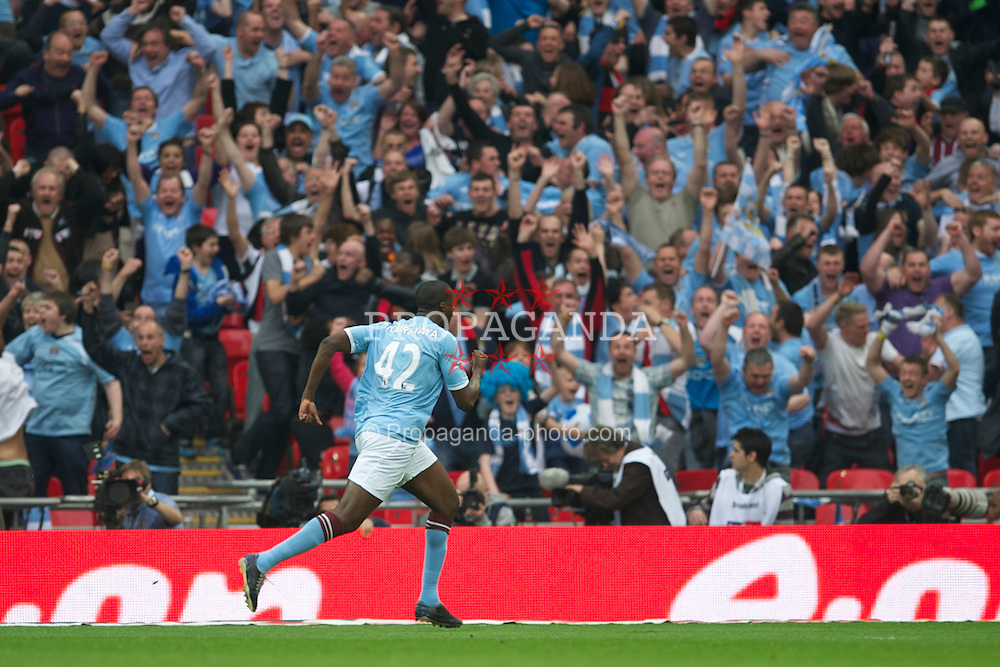 LONDON, ENGLAND - Saturday, April 16, 2011: Manchester City's Yaya Toure celebrates scoring the first goal against Manchester United during the FA Cup Semi-Final match at Wembley Stadium. (Photo by David Rawcliffe/Propaganda)