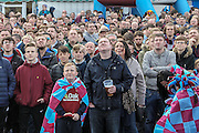 Burnley fans looking up to watch the Brighton game on large screens outside the ground before the Sky Bet Championship match between Burnley and Queens Park Rangers at Turf Moor, Burnley, England on 2 May 2016. Photo by Mark P Doherty.