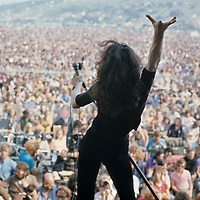 Paul Rodgers - Free .Lead singer Paul Rodgers went on to form rock band Bad Company initially in the 1970's, but in 2008 he was chosen to be front man for Queen. Here, striking a typical Freddy Mercury pose, he can be seen practicing for the role 38 years in advance..The Isle of Wight Music Festival 1970..Photograph by Charles Everest