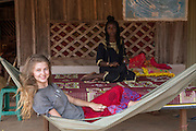 ICS volunteer Megan Lambert relaxing after lunch in the village of in Banteay Char, near Battambang, Cambodia.