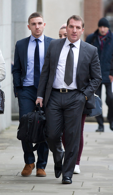 © Licensed to London News Pictures. 06/02/2013. London, UK. Brighton and Hove Albion football player Anton Rodgers, 20, (L) is seen arriving at the Old Bailey with his father, Liverpool football club manager Brendan Rodgers, in London today (06/02/13) where he (Anton) and four other players are facing charges of sexual assault. Photo credit: Matt Cetti-Roberts/LNP