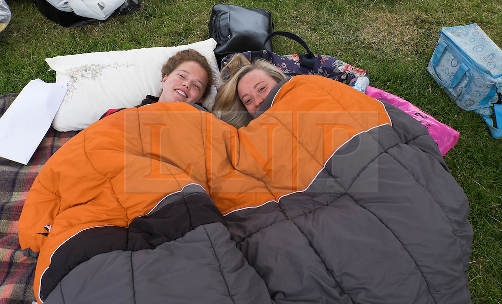 © Licensed to London News Pictures.13/06/15<br /> Durham, England.<br /> <br /> Two rowers relax in their sleeping bags after camping out on the riverbank during the 182nd Durham Regatta rowing event held on the River Wear. The origins of the regatta date back  to commemorations marking victory at the Battle of Waterloo in 1815. This is the second oldest event of this type in the country and attracts over 2000 competitors from across the country.<br /> <br /> Photo credit : Ian Forsyth/LNP