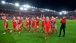 SOUTHAMPTON, ENGLAND - Friday, April 6, 2018: Wales' Natasha Harding and her team-mates celebrate after a hard fought goal-less draw against England during the FIFA Women's World Cup 2019 Qualifying Round Group 1 match between England and Wales at St. Mary's Stadium. (Pic by David Rawcliffe/Propaganda)