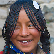 A drokpa, or Tibetan nomad, woman smiles outside of Ditrul Phuk Gompa on the kora, or circumabulation, of Mount Kailash, Tibet.