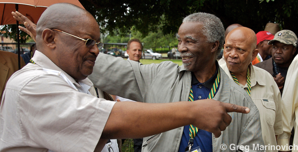 African National Congress President Thabo Mbeki (centre) waves to supporters as ANC chairman and Defence Minister Mosiuoa Lekota  points with ANC Trteasurer Mendi Msimang looks on (right) as Mbeki arrives to cast his vote at the African National Congress conference in Polokwane, South Africa, on Monday, Dec. 17, 2007. Photographer: Greg  Marinovich/Bloomberg News