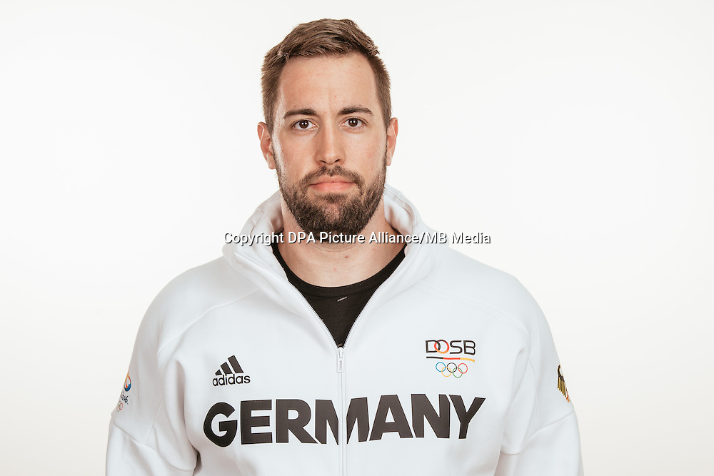 Tobias Dahm poses at a photocall during the preparations for the Olympic Games in Rio at the Emmich Cambrai Barracks in Hanover, Germany, taken on 21/07/16 | usage worldwide