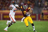 24 October 2009: Wide receiver (8) Ronald Johnson of the USC Trojans catches a pass and runs for a first down and stiff arms cornerback (21) Tim Clark of the Oregon St. Beavers during the first half of USC's 42-36 victory over Oregon St. at the Coliseum in Los Angeles, CA