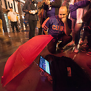 Chicago Cubs fan watch game 7 on a laptop computer outside Wrigley Field.  Cubs won the World Series against the Cleveland Indians in 7 games.<br />