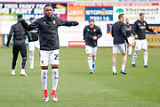 Notts County defender Cedric Evina (25) warming up  during the EFL Sky Bet League 2 match between Mansfield Town and Notts County at the One Call Stadium, Mansfield, England on 8 December 2018.