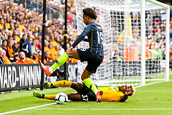 Leroy Sane of Manchester City is tackled by Adama Traore of Wolverhampton Wanderers - Mandatory by-line: Robbie Stephenson/JMP - 25/08/2018 - FOOTBALL - Molineux - Wolverhampton, England - Wolverhampton Wanderers v Manchester City - Premier League