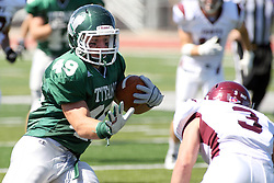 08 September 2012:  Cameron Blossom gets set to stiff arm Andrew Funsch during an NCAA division 3 football game between the Alma Scots and the Illinois Wesleyan Titans which the Titans won 53 - 7 in Tucci Stadium on Wilder Field, Bloomington IL