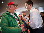 28 JANUARY 2020 - OSCEOLA, IOWA: PETE BUTTIGIEG talks to a man on the rope line after speaking at a campaign event at the Clarke County Fairgrounds in Osceola, about 50 miles south of Des Moines. Buttigieg talked to a crowd of about 130 people in Osceola. Buttigieg, the former mayor of South Bend, Indiana, is running to be the Democratic nominee for President in the 2020 election. Iowa traditionally holds the first presidential selection event of the 2020 election cycle. The Iowa Caucuses are on Feb. 3, 2020.     PHOTO BY JACK KURTZ