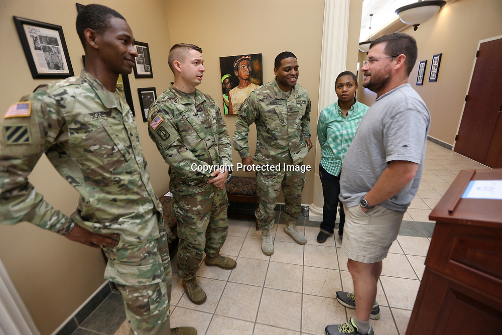 Tupelo City Council President Lynn Bryan, right, talks with soldiers from the local Army recruiters office in Tupelo after reading a proclamation commemorationg U.S. Army in city hall Wednesday morning.