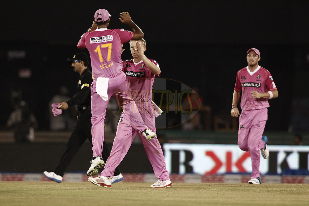 Ish Sodhi , Scott Kuggeleijn of the NORTHERN KNIGHTS celebrates the wicket of Hashim Amla of Cape Cobras during match 3 of the Oppo Champions League Twenty20 between the Cape Cobras and the Northern Knights held at the Chhattisgarh International Cricket Stadium, Raipur, India on the 19th September 2014<br /> <br /> Photo by:  Deepak Malik / Sportzpics/ CLT20<br /> <br /> <br /> Image use is subject to the terms and conditions as laid out by the BCCI/ CLT20.  The terms and conditions can be downloaded here:<br /> <br /> http://sportzpics.photoshelter.com/gallery/CLT20-Image-Terms-and-Conditions-2014/G0000IfNJn535VPU/C0000QhhKadWcjYs