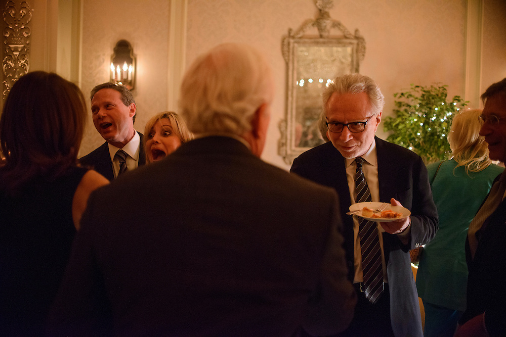 "Photo by Matt Roth.Assignment ID: 10137379A..Wolf Blitzer, left, greets a party goer at the same time Dr. Tina Alster, left, reacts to seeing Wolf's wife, Lynn Blitzer during an inaugural ""Bi-Partisan Celebration"" hosted by Buffy and Bill Cafritz, Ann and Vernon Jordan, Vicki and Roger Sant threw at the Dolley Madison Ballroom at the Madison Hotel in Washington, D.C. on Monday, January 21, 2013. Wayne Reynold, far left, DC philanthropist. ."