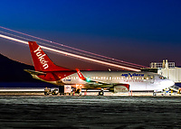 The lights of another aircraft streak across the dawn sky as Air North's Boeing 737-500 C-FANF prepares to depart to Vancouver