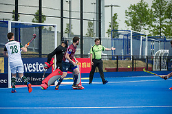 Phil Ball's half volley to open the scoring for Wimbledon. Wimbledon v Surbiton - Men's Hockey League Final, Lee Valley Hockey & Tennis Centre, London, UK on 23 April 2017. Photo: Simon Parker
