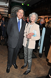 LORD BRITTAN OF SPENNITHORNE and LADY HOWELL at a party to celebrate the publication of Sandra Howard's new book - Ex-Wives held at Daunt Books, 83 Marylebone High Street, London W1 on 30th April 2012.
