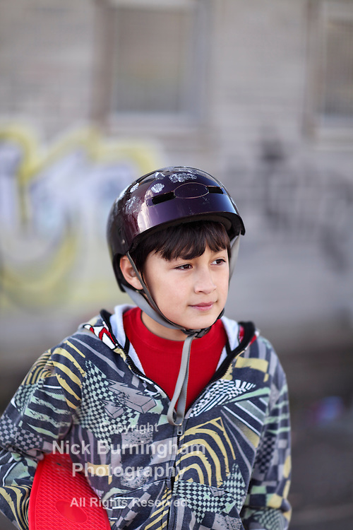 Boy with Skateboard Helmet in the Park