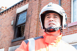 © Licensed to London News Pictures . 08/07/2017 . Bolton , UK . Assistant County Fire Officer TONY HUNTER for Greater Manchester Fire and Rescue at a press conference in front of the house . Scene on Rosamond Street in Daubhill , where a fatal house fire burned through a mid-terrace house this morning (Saturday 8th July 2017) . Firefighters responded at 9am this morning (Saturday 8th July 2017) . A family of five are reported to have been inside at the time and there are understand to me multiple fatalities . Photo credit : Joel Goodman/LNP