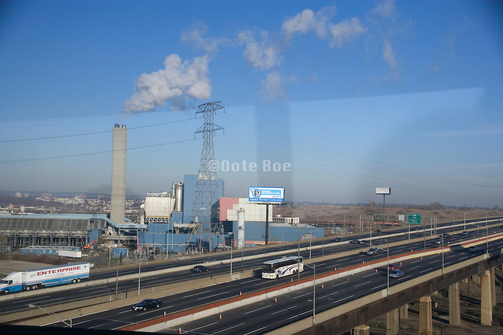 industrial landscape with highway in the foreground seen through a window