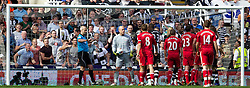 NEWCASTLE-UPON-TYNE, ENGLAND - Sunday, April 1, 2012: Liverpool's goalkeeper Jose Reina looks dejected after clashing with Newcastle United's James Perch, which leads to his sending off by referee Martin Atkinson, during the Premiership match at St James' Park. (Pic by Vegard Grott/Propaganda)