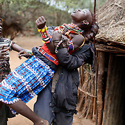 A man holds a girl as she tries to escape when she realised she is to to be married.