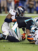 Denver Broncos outside linebacker Von Miller (58) pushes the ball backwards after knocking the ball out of the hands of Carolina Panthers quarterback Cam Newton (1) causing a fumble recovered by the Denver Broncos and setting up the game winning score during the NFL Super Bowl 50 football game against the Carolina Panthers on Sunday, Feb. 7, 2016 in Santa Clara, Calif. The Broncos won the game 24-10. (©Paul Anthony Spinelli)
