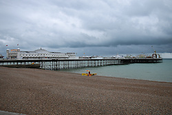 © Licensed to London News Pictures. 22/06/2015. Brighton, UK. Few people venture out on Brighton beach today as dark clouds loom over Brighton, today June 22nd 2015. Photo credit : Hugo Michiels/LNP