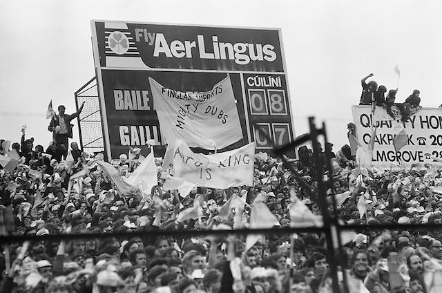 Crowds of supporters waving flags and various banners seated under the score board during the All Ireland Senior Gaelic Football Championship Final Dublin V Galway at Croke Park on the 22nd September 1974. Dublin 0-14 Galway 1-06.