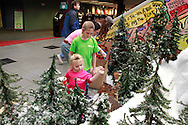 Lilian Busse, 11 watches sister Ella, 3 of Alexandria, Kentucky add some snow as the Huntington Holiday Train display setup nears completion at the main branch of the Columbus Metropolitan Library in downtown Columbus, Sunday, November 25, 2012..The trains are setup by Applied Imagination on Saturday and Sunday and will run through mid-January.