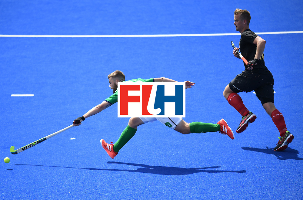 Ireland's Alan Sothern stretches for the ball during the men's field hockey Ireland vs Canada match of the Rio 2016 Olympics Games at the Olympic Hockey Centre in Rio de Janeiro on August, 11 2016. / AFP / MANAN VATSYAYANA        (Photo credit should read MANAN VATSYAYANA/AFP/Getty Images)