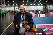 Heiko Wagner - a German judge and also participant with his dog posing for a photograph at the Leipzig Trade Fair. Over 31,000 dogs from 73 nations will come together from 8-12 November 2017 in Leipzig for the biggest dog show in the world.