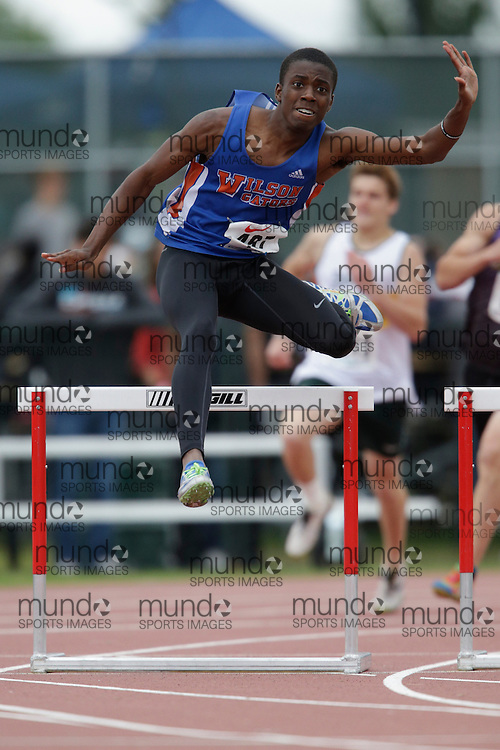 Chris Miller of Donald A. Wilson SS - Whitby competes in the intermediate hurdle heats at the 2013 OFSAA Track and Field Championship in Oshawa Ontario, Saturday,  June 8, 2013.<br /> Mundo Sport Images/ Geoff Robins