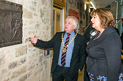 Pictured: Scottish Government Public Libraries Funding Announcement. Culture Minister Fiona Hyslop announces this year's successful bids to the £450,000 Public Library Improvement Fund (PLIF) at the John Grey Centre, Haddington Library, Haddington, East Lothian, Scotland, United Kingdom.  PLIF has been supporting innovative library projects since 2006 which help both individuals and communities. Fiona Hyslop with Provost of East Lothian, John McMillan looking at a sculpture about an East Lothian family who lost  sons in Worl War 1. had 11 children. Seven of their sons went to fight, four died and two were terribly wounded. Only one returned home unscathed. 13 December 2018  <br /> <br /> Sally Anderson | EdinburghElitemedia.co.uk