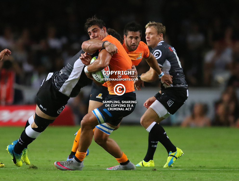 DURBAN, SOUTH AFRICA, 5, MARCH, 2016 -  Marcell Coetzee of the Cell C Sharks looks to tackle Pablo Matera of the Jaguares during The Cell C Sharks vs Jaguares Super Rugby match at Growthpoint Kings Park in Durban, South Africa. (Photo by Anesh Debiky)