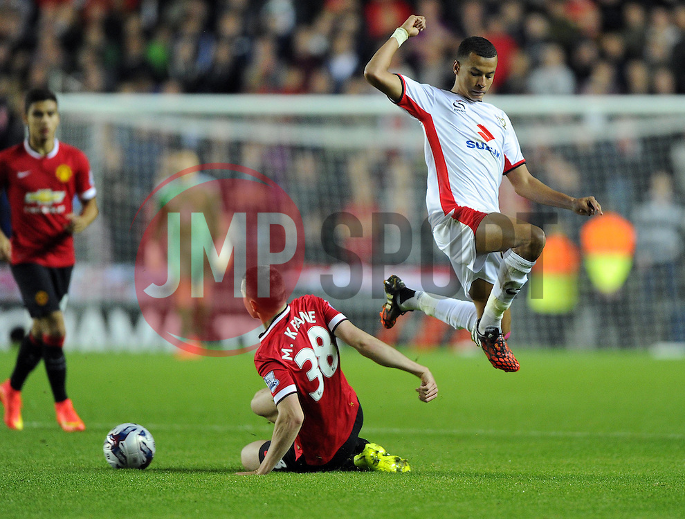 Milton Keynes Dons'  tackles Milton Keynes Dons' Dele Alli - Photo mandatory by-line: Joe Meredith/JMP - Mobile: 07966 386802 26/08/2014 - SPORT - FOOTBALL - Milton Keynes - Stadium MK - Milton Keynes Dons v Manchester United - Capital One Cup