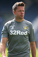 James Beattie, the Leeds United 1st team coach  on pitch preparing for the players to warm up before k/o.Skybet EFL championship match, Queens Park Rangers v Leeds United at Loftus Road Stadium in London on Sunday 7th August 2016.<br /> pic by John Patrick Fletcher, Andrew Orchard sports photography.